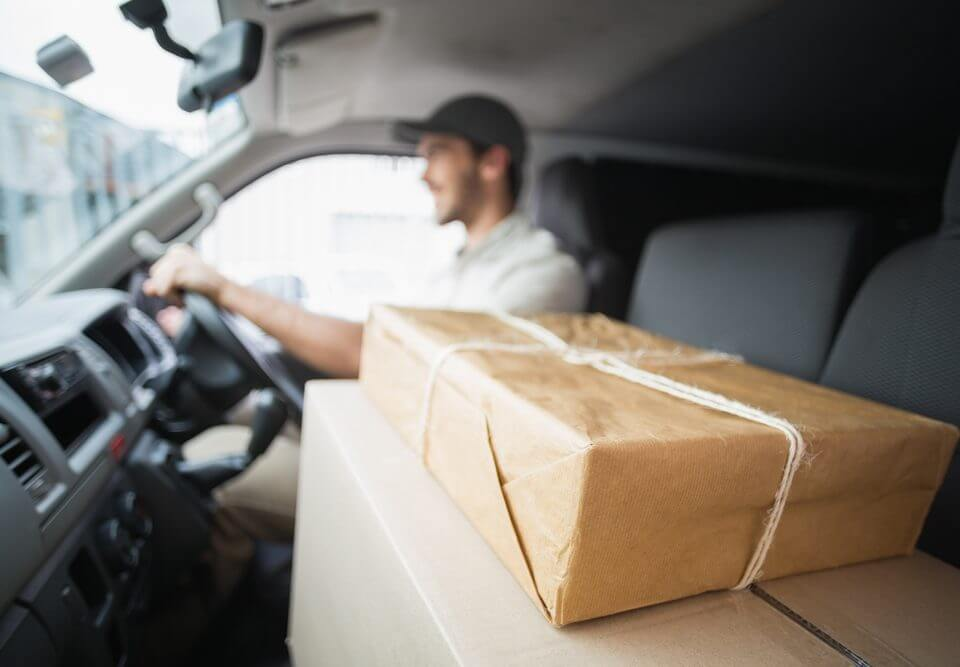 delivery driver with packages in the front seat