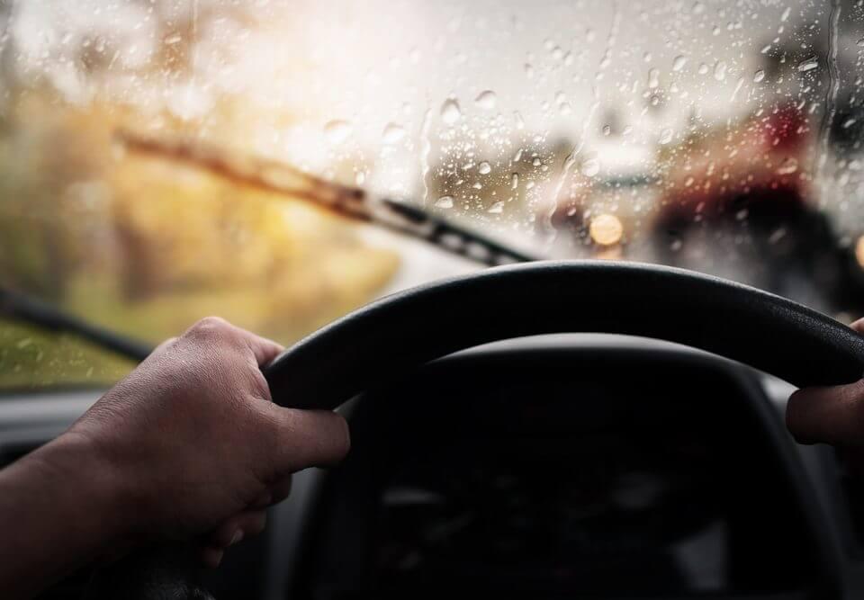 inside of a car dashboard in the rain