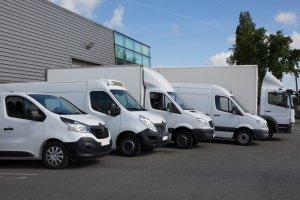 fleet of delivery trucks and vans