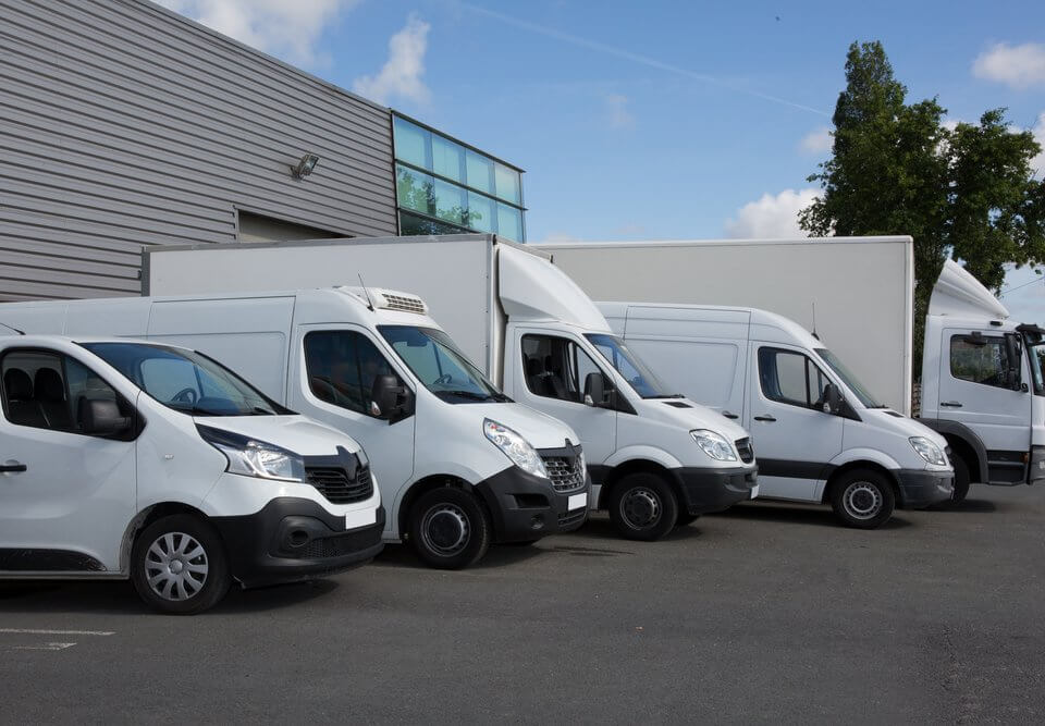 fleet of delivery trucks and vans