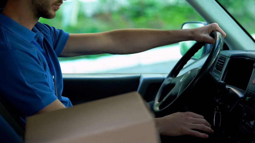 delivery driver with a package