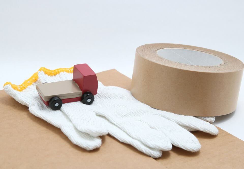 white gloves, little truck, and box