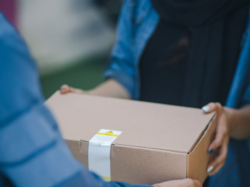 man handing a woman a package